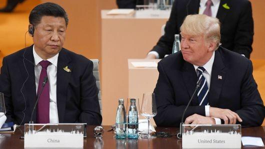 Chủ tịch Trung Quốc Tập Cận Bình (trái) và Tổng thống Mỹ Donald Trump tại hội nghị G20 ở Đức ngày 7-7-2017. Ảnh: AFP