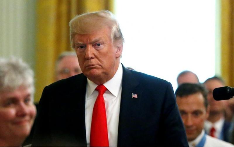 Tổng thống Mỹ Donald Trump tại buổi lễ trao tặng huân chương danh dự cho một sĩ quan không quân tại Nhà Trắng ngày 22-8. Ảnh: REUTERS