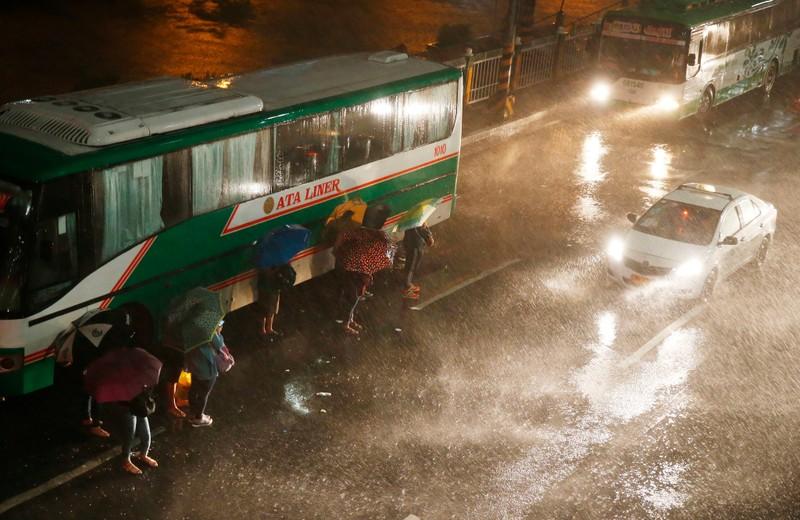 Thủ đô Manila (Philippines) cũng bị mưa lớn vì ảnh hưởng bão Mangkhut, sáng sớm 15-9. Ảnh: AP