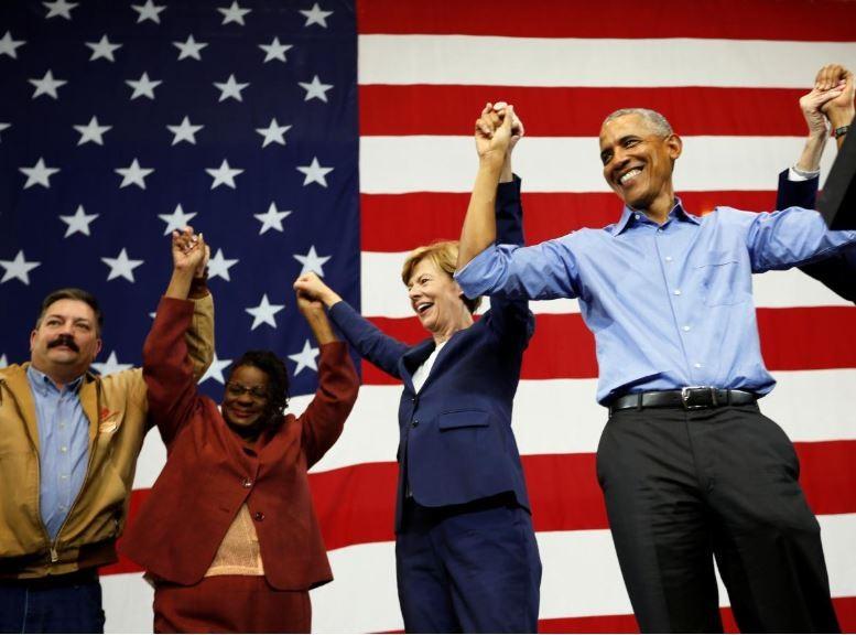 Đảng Dân chủ của cựu Tổng thống Barack Obama có cơ hội thắng ở Hạ viện. Ông Obama vận động cho các ứng viên Dân chủ ở bang Wisconsin ngày 26-10. Ảnh: REUTERS
