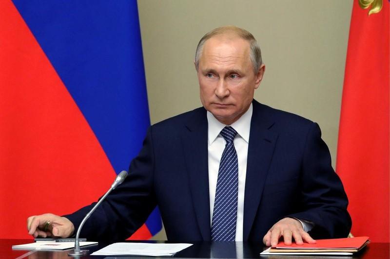 Tổng thống Nga Vladimir Putin cảnh báo rằng Nga sẽ buộc phải khởi động phát triển các tên lửa hạt nhân tầm ngắn và tầm trung phóng từ mặt đất nếu Mỹ thực hiện điều này trước. Ảnh: WSJ