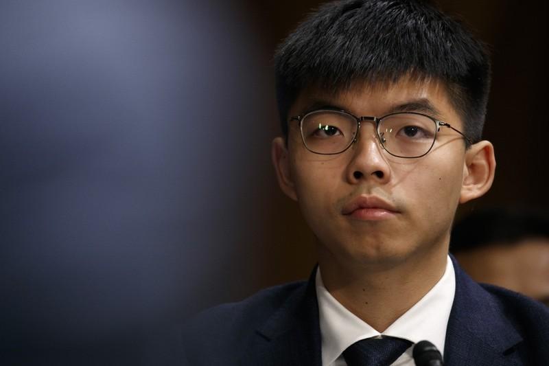 Hoàng Chi Phong vừa bị tòa án Hong Kong cấm đi London (Anh) để nhận giải thưởng về nhân quyền từ Quốc hội Anh. Ảnh: AP