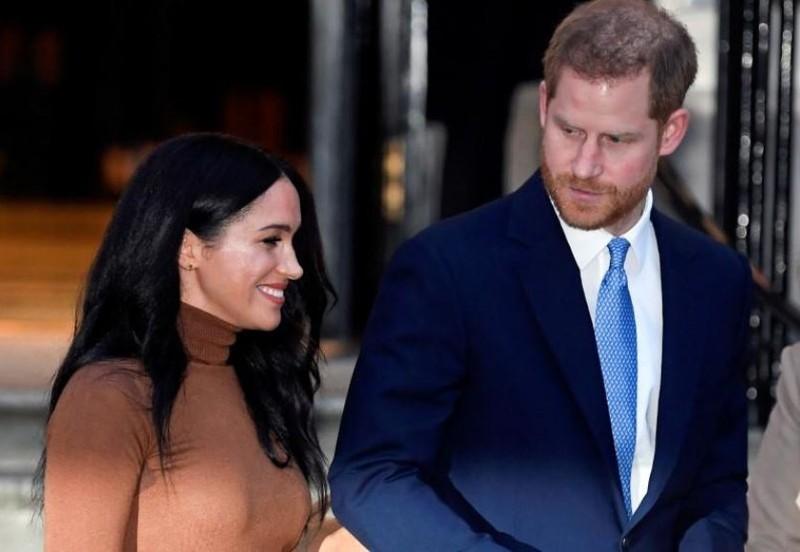 Vợ chồng Hoàng tử Harry và Meghan tại London (Anh) ngày 7-12. Ảnh: REUTERS