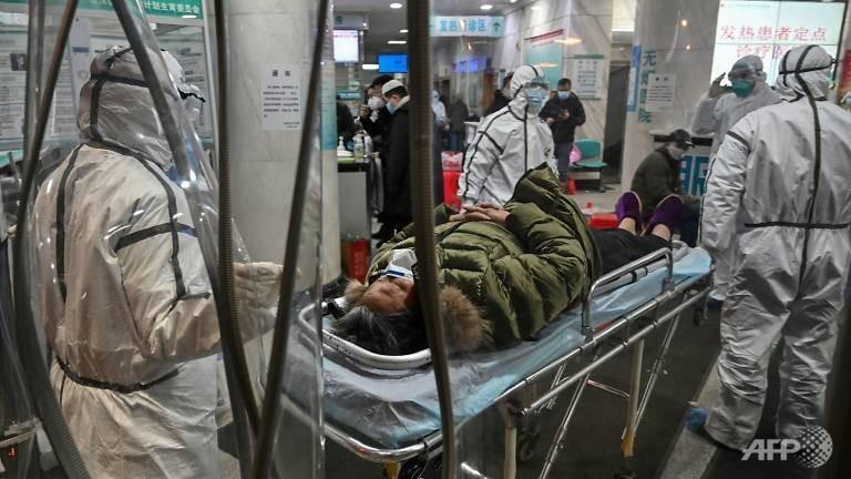 Bác sĩ ở Vũ Hán đang phải chạy đua với thời gian và đương đầu với bao khó khăn chiến đấu với dịch virus Corona. Ảnh: THX