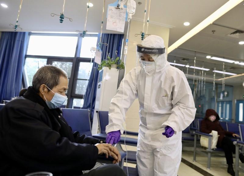 COVID-19 Trung Quốc: Nhiễm mới chỉ 19, lại lo nhiễm nhập cảnh - ảnh 1