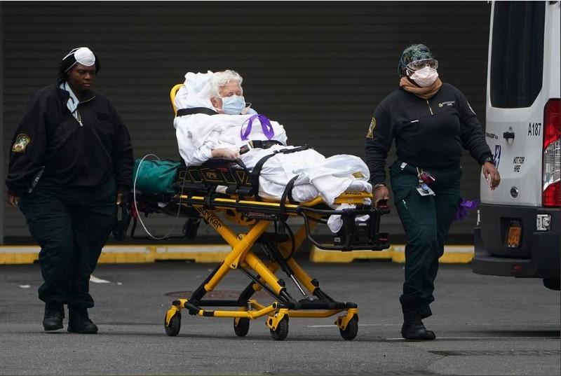 COVID-19 Mỹ: Chết hơn 1.000, kỷ lục 16.000 ca nhiễm mới 1 ngày - ảnh 1