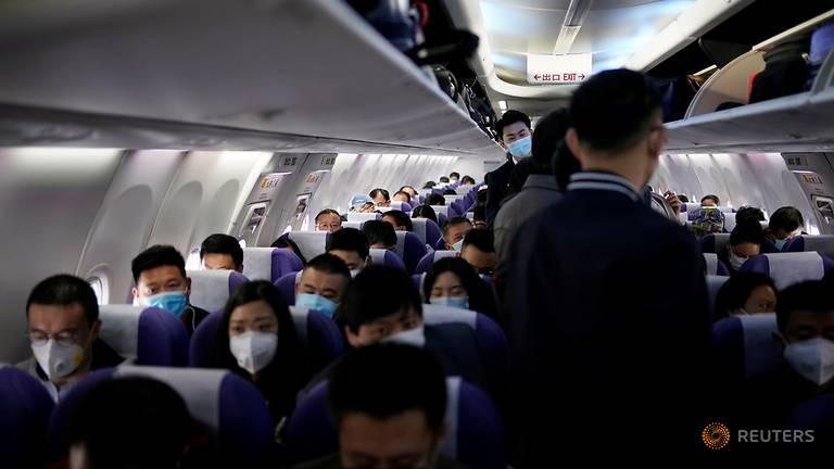 COVID-19: Trung Quốc ngưng các chuyến bay từ nước ngoài về - ảnh 1