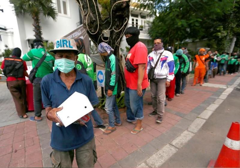 Chết vì COVID-19: Indonesia xếp thứ hai Đông Á, sau Trung Quốc - ảnh 2