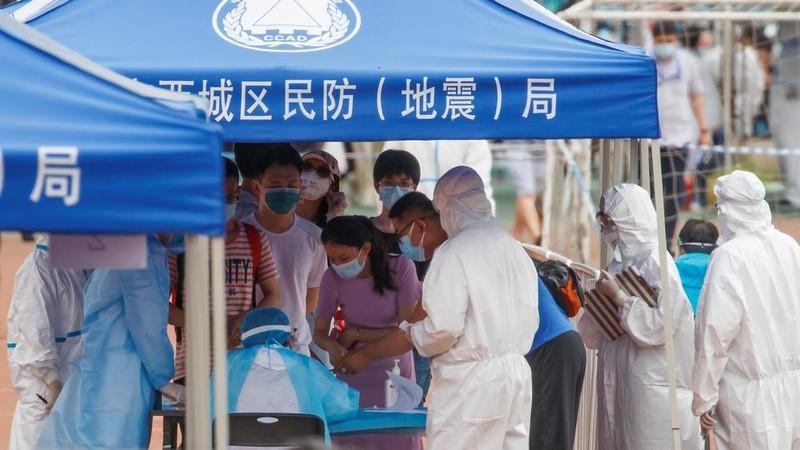 WHO báo động và điều tra ổ dịch COVID-19 mới ở Bắc Kinh - ảnh 1