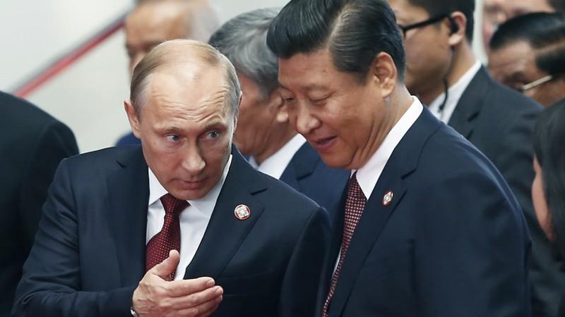Trung Quốc tranh thủ Nga, bắt tay Iran đối phó Mỹ - ảnh 1