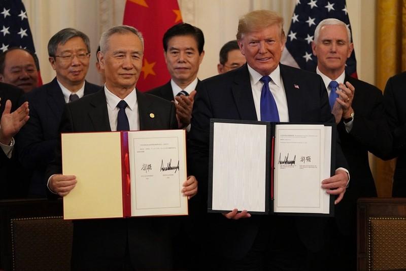 Trung Quốc thúc giục bỏ thuế quan, Mỹ không vội - ảnh 1