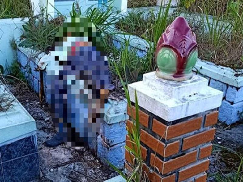 Phát hiện thi thể người đàn ông đang phân hủy ở nghĩa trang - ảnh 1