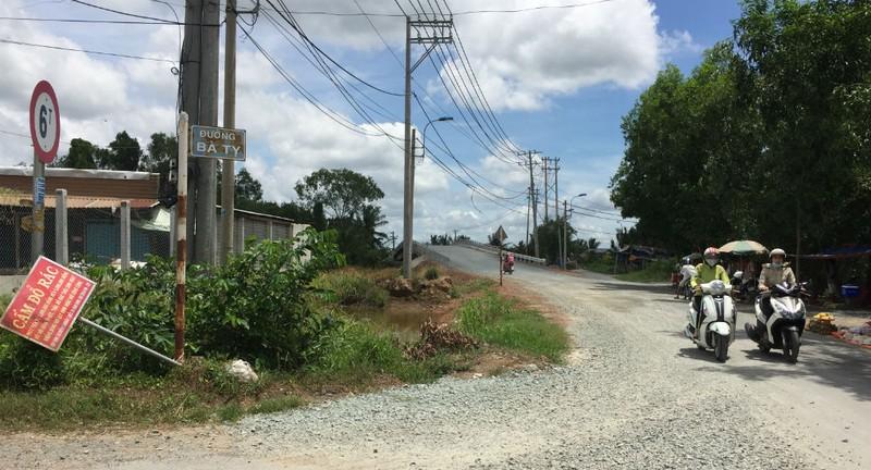 Bình Chánh: Cầu vẫn chờ, đường vẫn đợi - ảnh 8