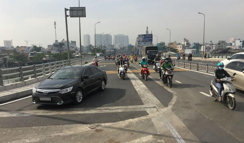 Hoàn thành mở rộng cầu Nguyễn Tri Phương trước ba tháng - ảnh 1