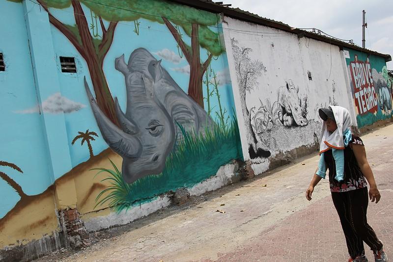 Ngắm những bức tường bẩn ở quận 1 được thay áo mới - ảnh 3