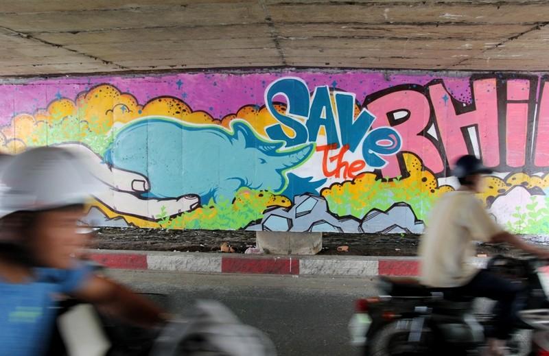 Ngắm những bức tường bẩn ở quận 1 được thay áo mới - ảnh 8