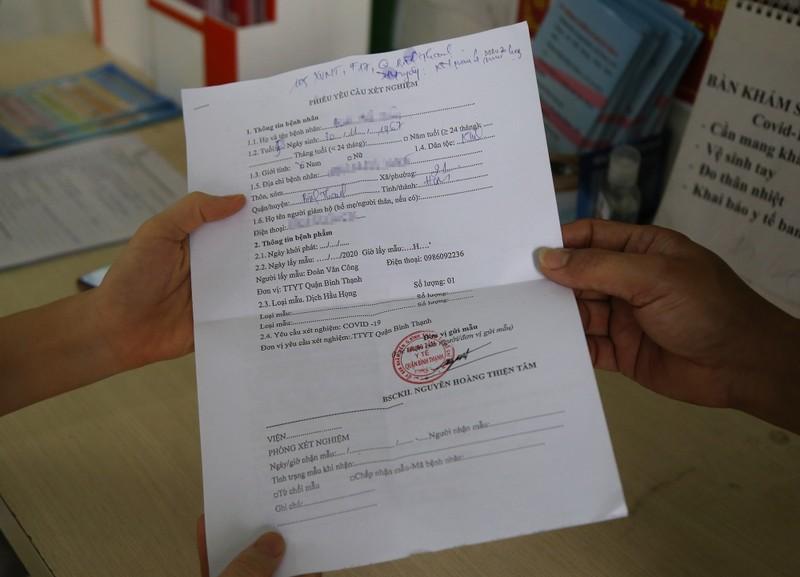 Xem quy trình xét nghiệm COVID-19 cho người về từ Đà Nẵng - ảnh 3