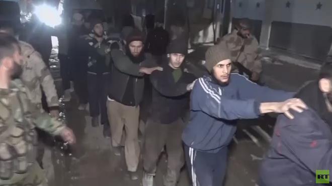 Phiến quân buông vũ khí, rời khỏi Đông Ghouta - ảnh 2