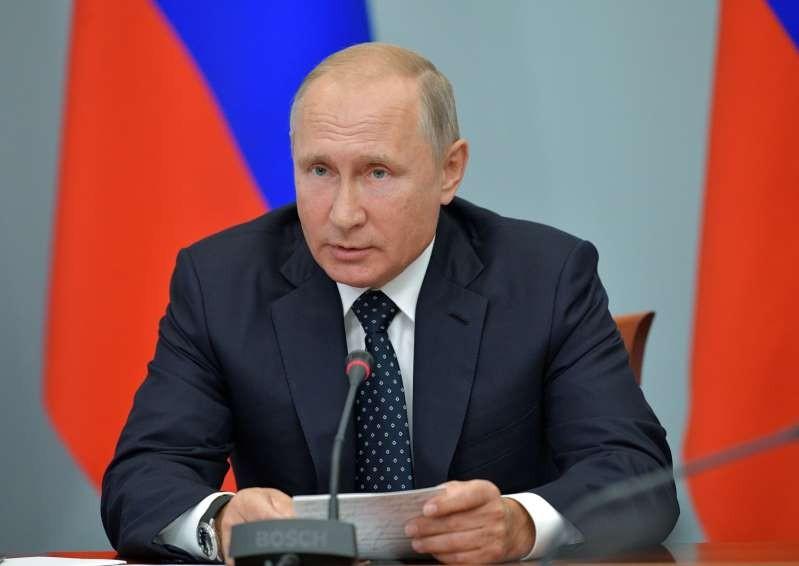 Ông Putin sa thải 15 tướng lĩnh trước tập trận lịch sử - ảnh 1
