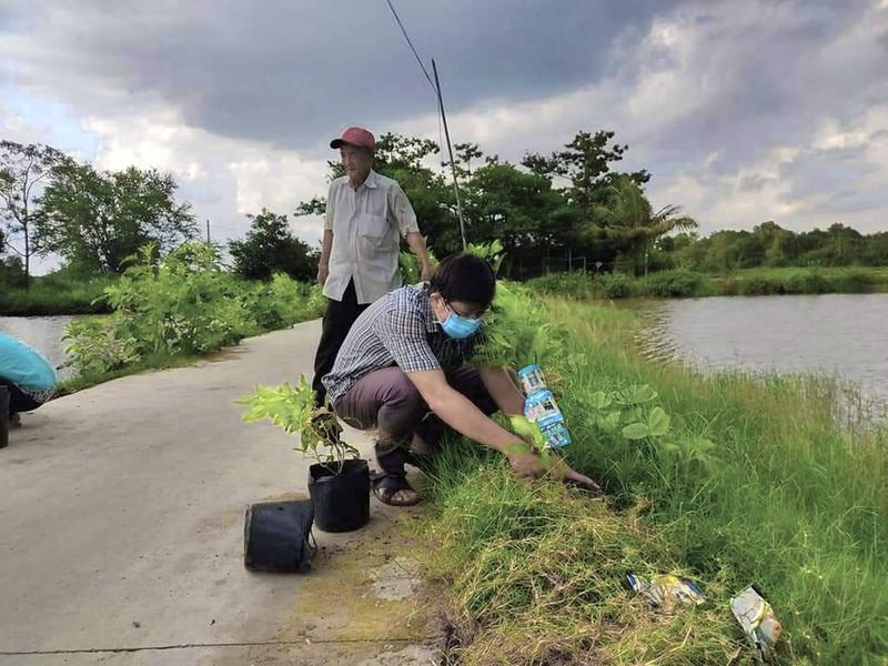 Huyện Bình Chánh: Xóa được nhiều điểm đen về rác - ảnh 1