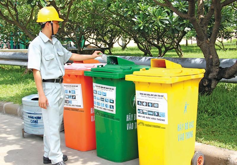 Sẽ thu phí rác thải tính theo khối lượng… - ảnh 1