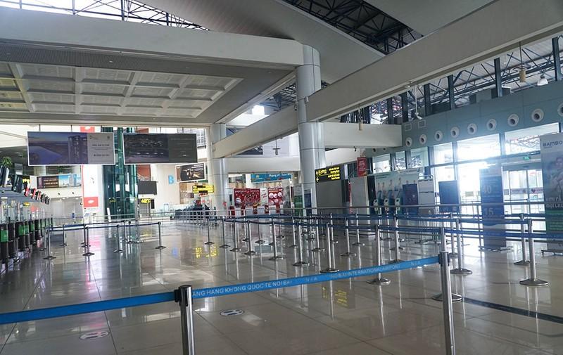 Cận cảnh sân bay Nội Bài ngày đầu mở cửa đón khách trở lại - ảnh 8