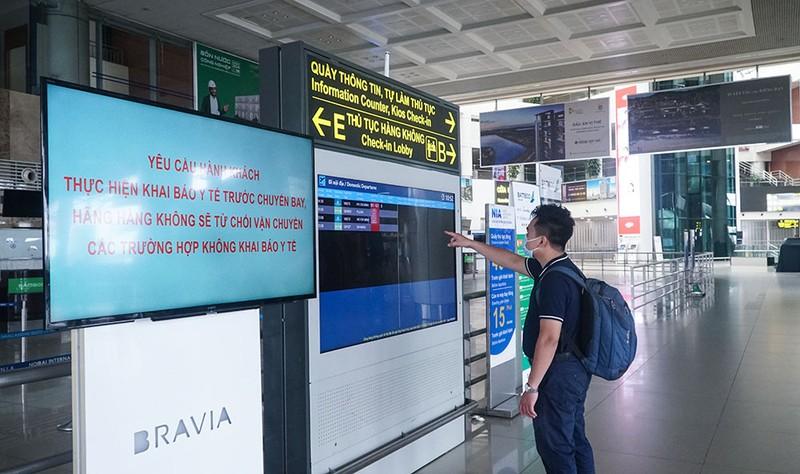 Cận cảnh sân bay Nội Bài ngày đầu mở cửa đón khách trở lại - ảnh 7