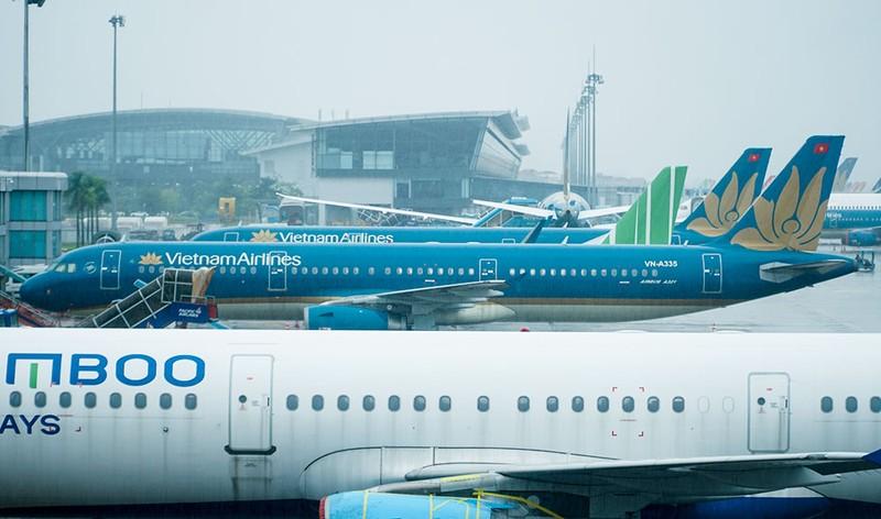 Những hành khách đầu tiên từ sân bay Nội Bài vào TP.HCM - ảnh 8