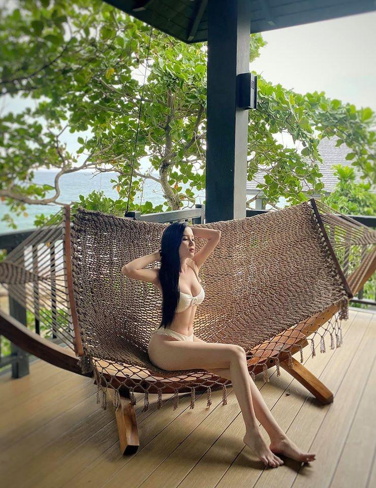 Hoa hậu Lương Thùy Linh khoe body với bikini gợi cảm - ảnh 5