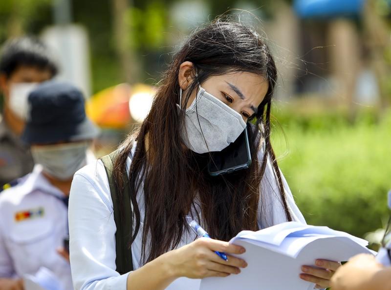 Chùm ảnh người nước ngoài đi tiêm vaccine tại TP.HCM - ảnh 2