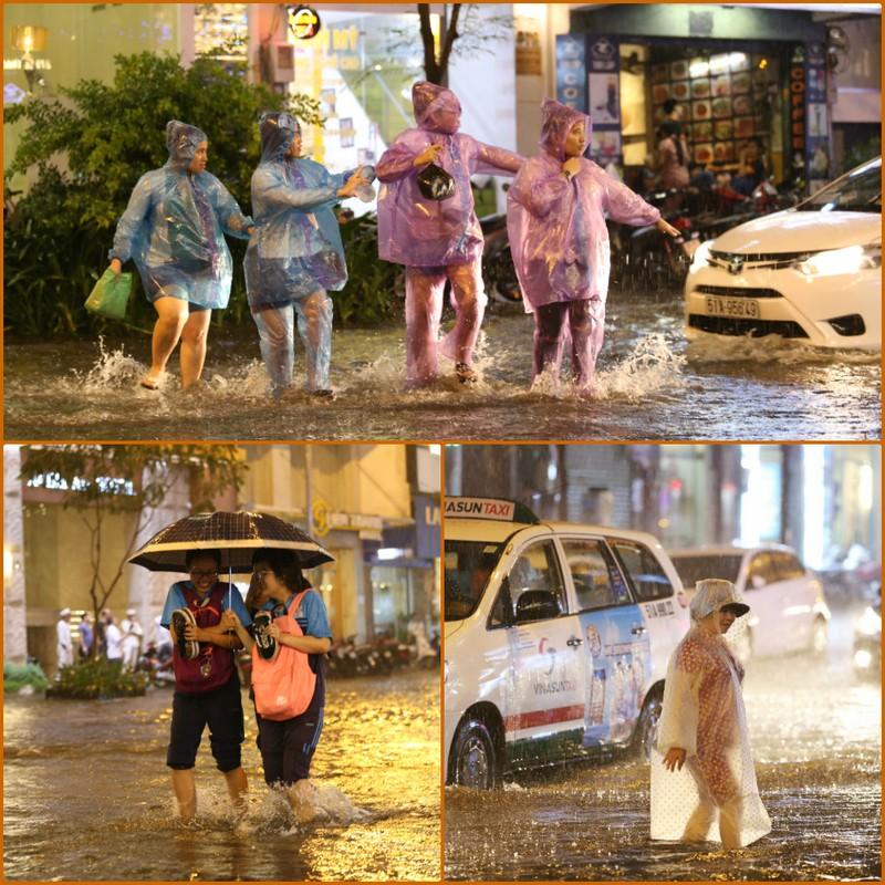 Chùm ảnh: Đường Sài Gòn ngập sau cơn mưa lớn - ảnh 1