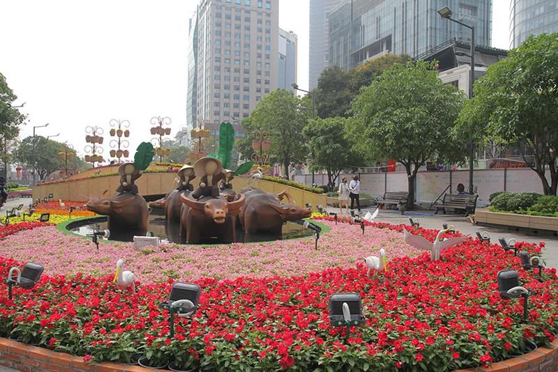 Cả một tuổi thơ ùa về khi đến đường hoa Nguyễn Huệ ngày Tết - ảnh 5