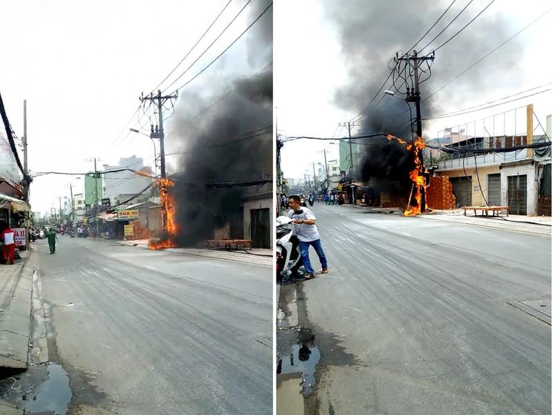 Trụ điện cháy dữ dội trên đường An Dương Vương, quận 6 - ảnh 1