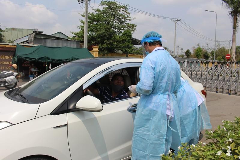 Quy trình xử lý khi chốt kiểm soát y tế phát hiện người sốt - ảnh 3