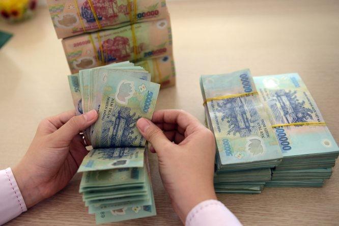 Mỹ không hạ lãi suất, tiền Việt thời gian tới sẽ ra sao? - ảnh 1