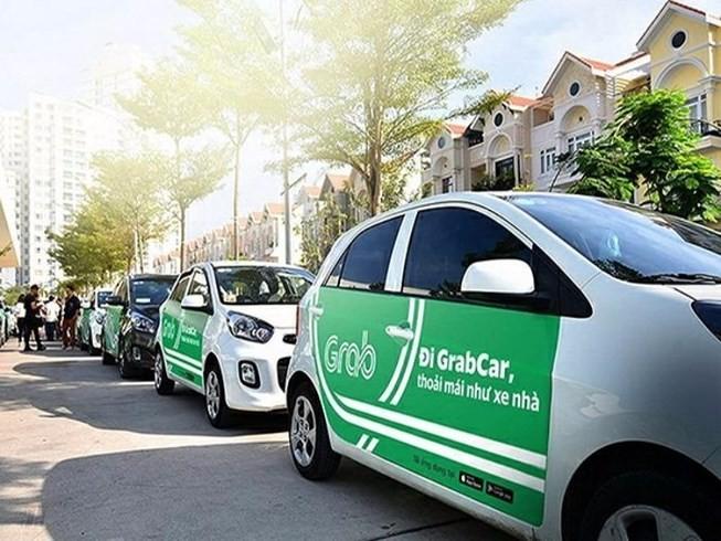 Grab thâu tóm Uber Việt Nam, mở rộng GrabFood - ảnh 1