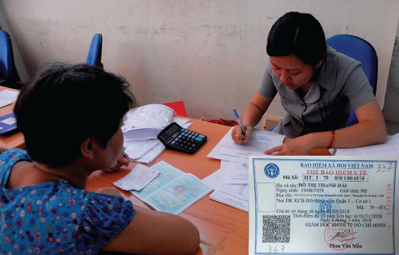 Đổi mã số bảo hiểm y tế mang nhiều lợi ích cho dân - ảnh 1