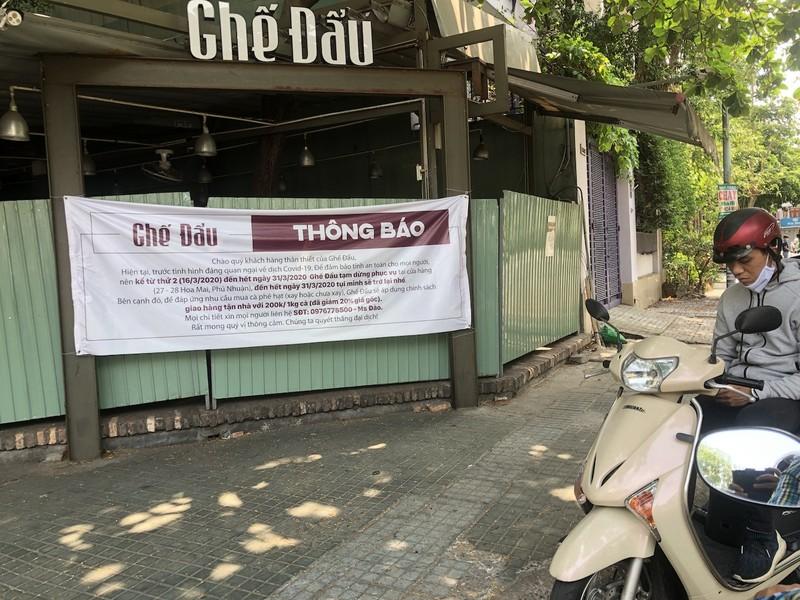 Hàng loạt quán ăn, salon tóc... đóng cửa chống dịch COVID-19 - ảnh 1