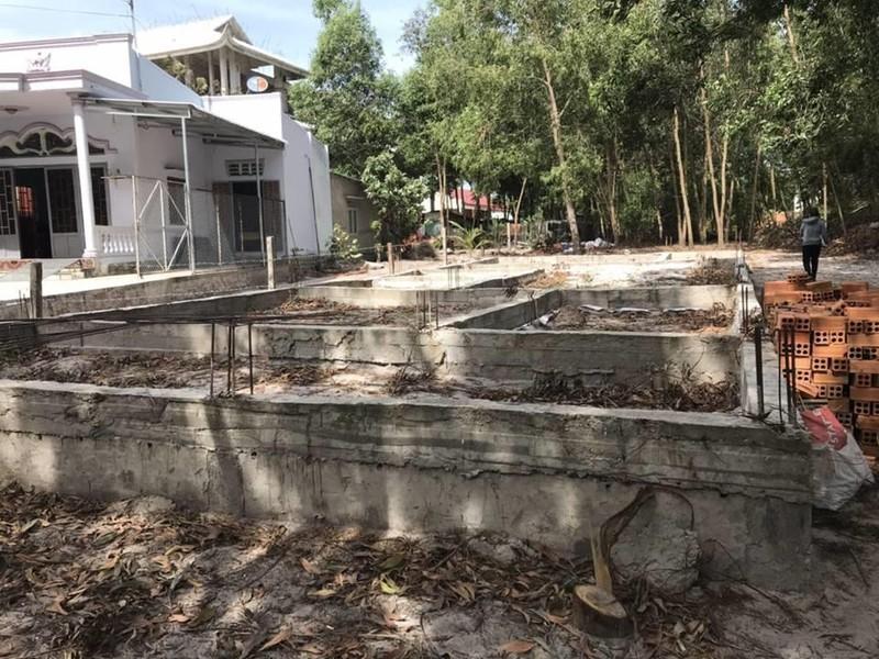 Chuyển hồ sơ vụ xây nhà trên đất hàng xóm sang công an - ảnh 1