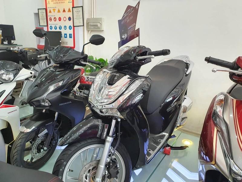 Honda SH bất ngờ giảm giá dịp cuối năm - ảnh 1