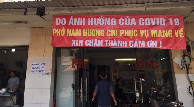 Các quán ăn, nhà hàng thực hiện nghiêm chống COVID-19 - ảnh 9