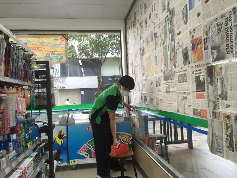 Chùm ảnh các siêu thị, cửa hàng tiện lợi đóng cửa sớm theo quy định - ảnh 6