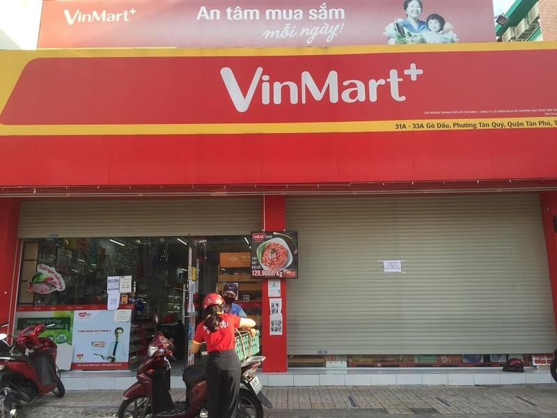 Chùm ảnh các siêu thị, cửa hàng tiện lợi đóng cửa sớm theo quy định - ảnh 1