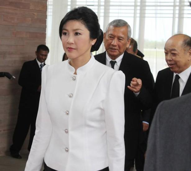 Cựu thủ tướng Thái Lan về nước để đối mặt với cuộc điều tra tham nhũng - ảnh 1